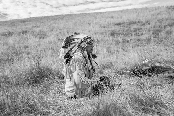 Chief Arvol Looking Horse sits near the Dakota Access Pipeline during a prayer. Cannon Ball, North Dakota, USA. November, 2016.