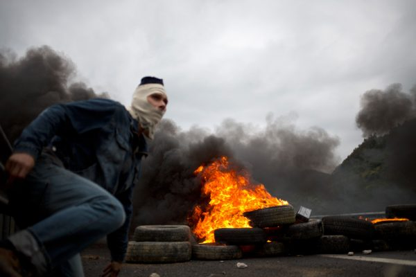 Coal miners cut A66 highway in Mieres Asturias where 6 hours ago have departed the 'Black Miners March' on foot to Madrid to protest against miners cuts. Battle between miners and special riot police in the middle of the town scared the citizens.