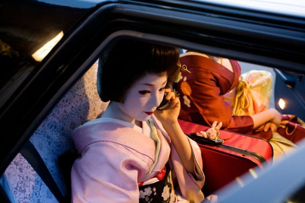 Komomo is fixing a date using her cellphone, a 26 years old geisha. She lives in Kyoto and study in Miyagawacho School of geishas, Kyoto, Japan